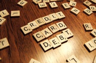 scrabble tiles spelling out credit card debt