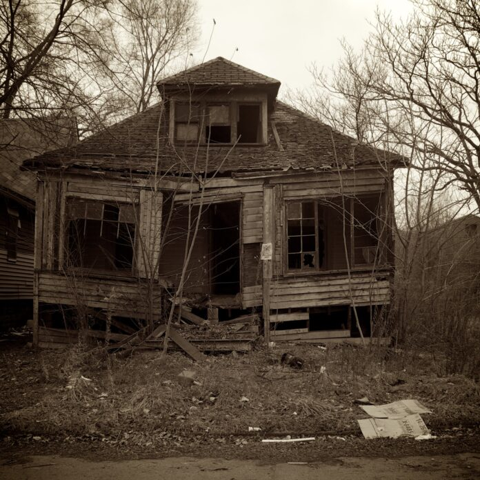 black and white photo of a ruined house