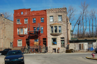 One of a trio of Chicago row houses undergoing repairs