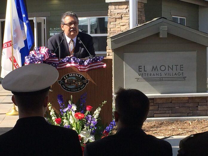 Speaker at opening ceremony at new homes for homeless Veterans