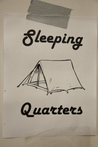 poster sketch of tent. The title is sleeping quarters.