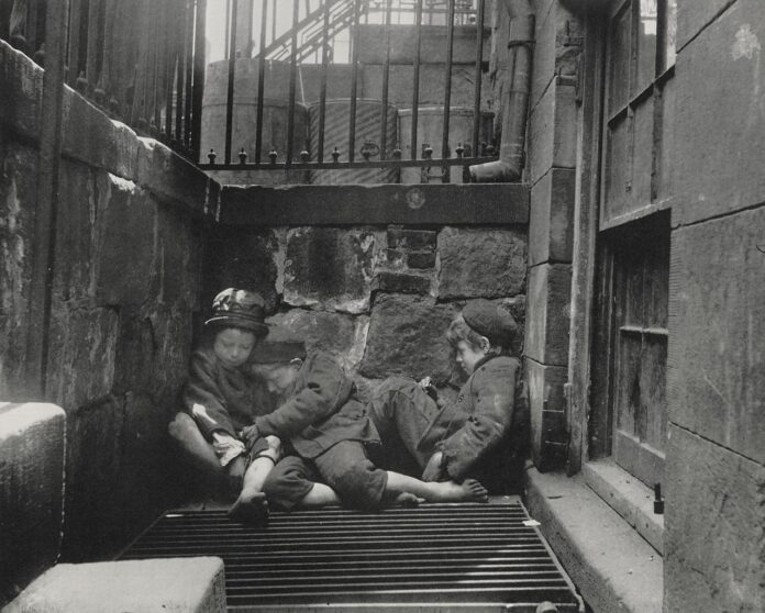 pre 1914 image of two children sleeping outdoors beside steps