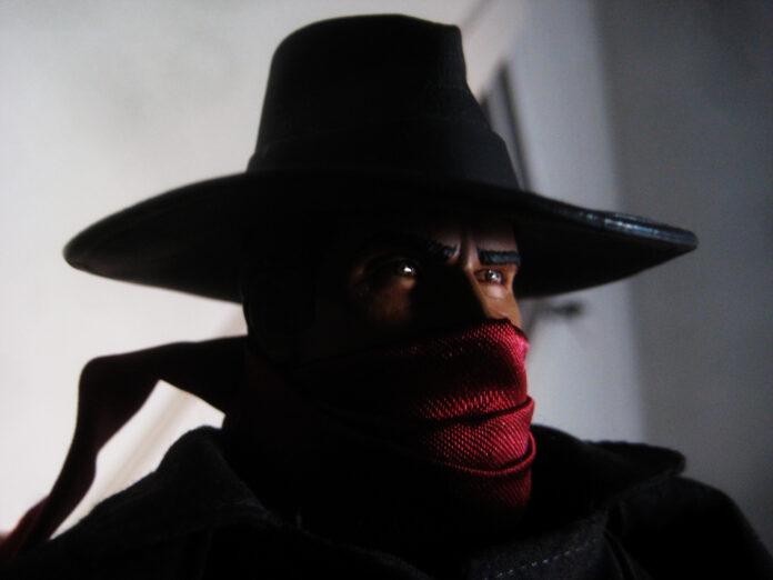 A shadowy black hat-clad individual