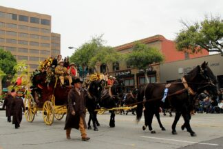 a replica Wells Fargo stagecoach pulled by horses in a recent Rose Bowl parade
