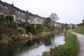 row houses backing on to a small canal