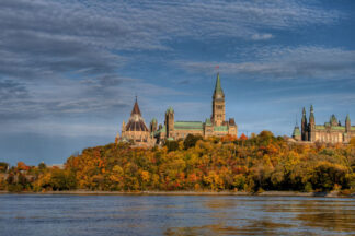 view of parliament hill from the Ottawa river