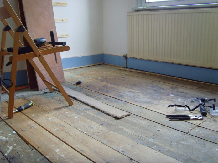 work tools are scattered about an unrefurbished room.
