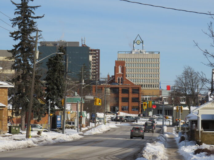 a small town appearance city center in winter, a modern clock tower in background