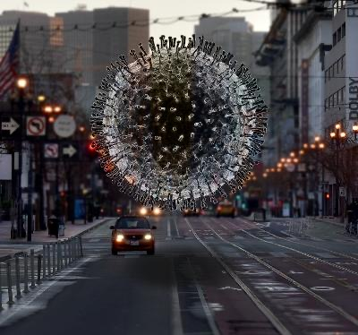 model of COVID-19 virus superimposed over a city street