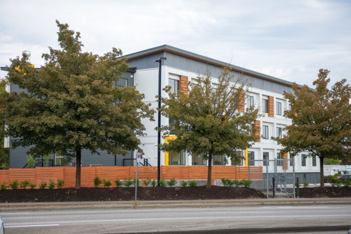 esterior of three storey supportive housing building in Vancouver