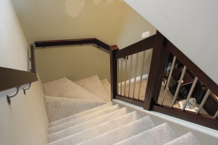 view down carpeted spiral staircase