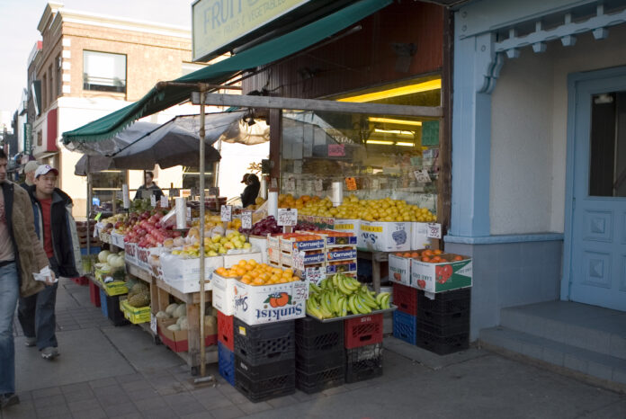 grocery storefront with fruit and vegetable display