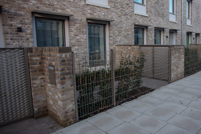 street level view of green social housing project in England