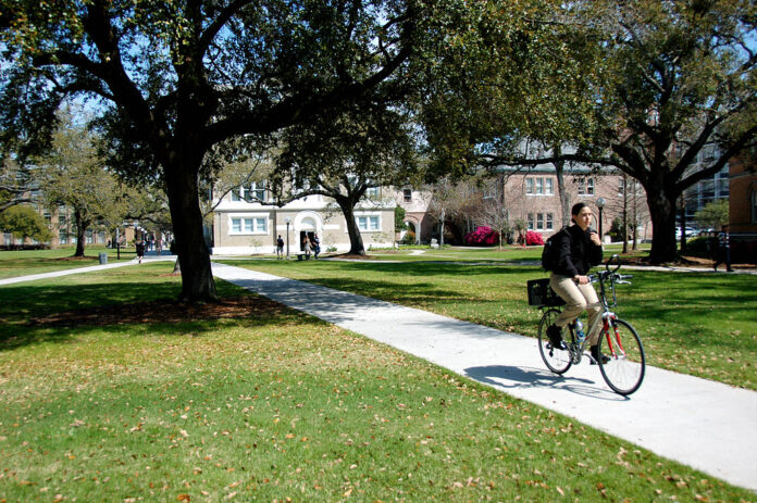 cyclist riding on university campus