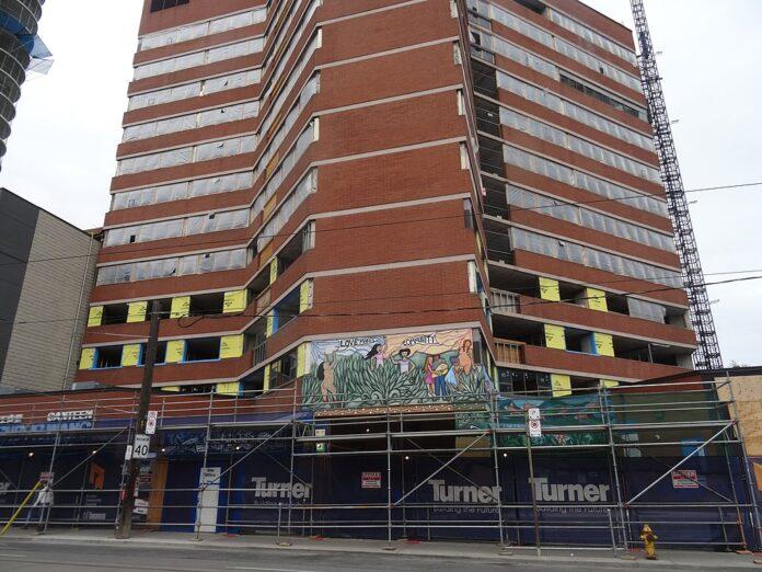 apartment building undergoing extensive repair
