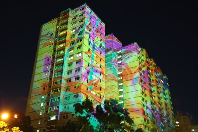 coloured light projected on public housing high rise building