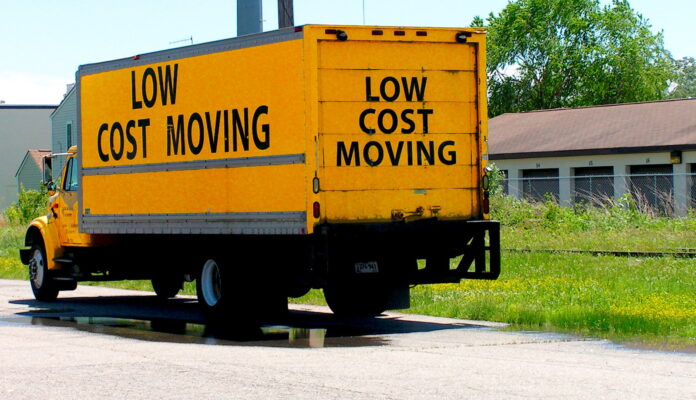 yellow truck bearing the words low cost moving