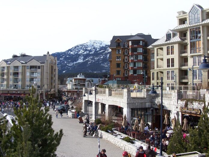 A plaza of shops below and Accommodations above surround a plaza