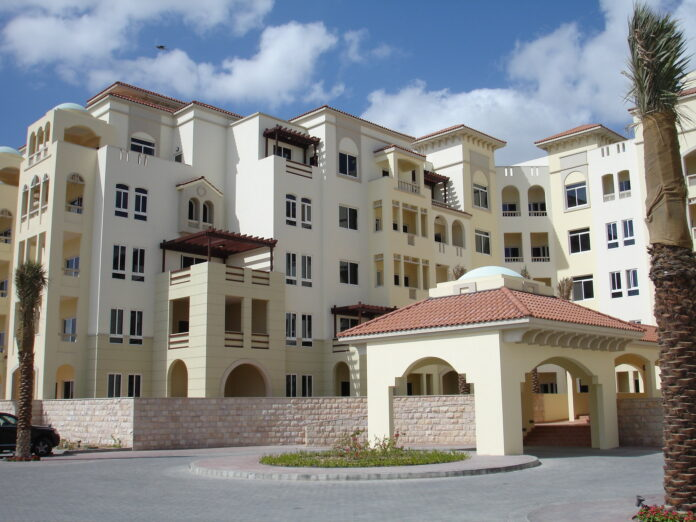 An attractive cream-coloured apartment building