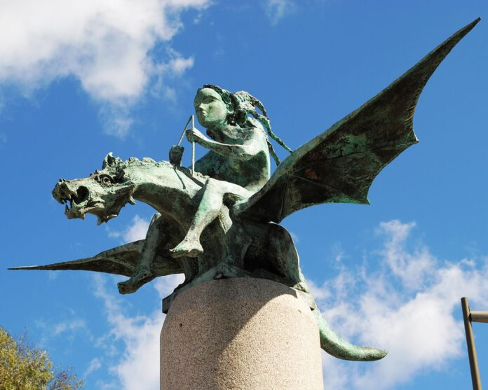 statue with child riding a dragon