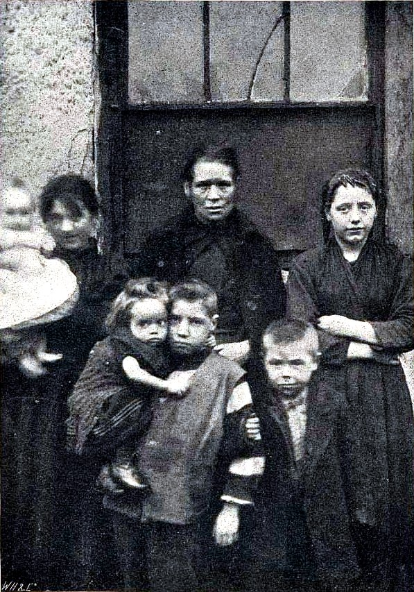 picture of two adults and five children, circa 1901