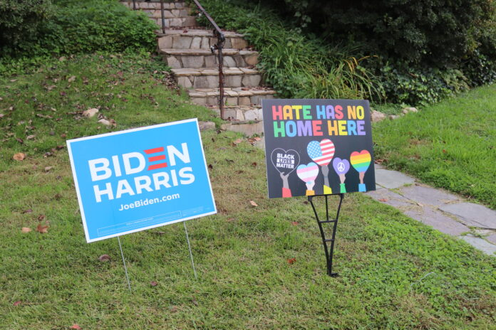 A Biden Harris election sign sits beside on saying 'Hate Has No Home Here'