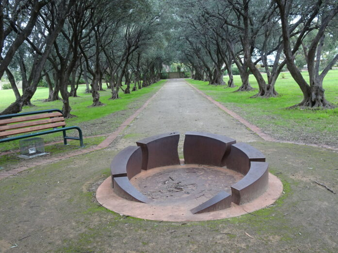 Empty park, empty paths, empty park bench