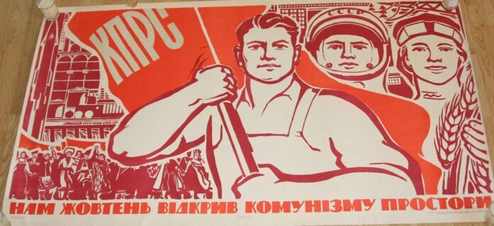 a traditional heroic propaganda poster in largely red colors featuring a worker, an astronaut and a 'statue of liberty??'