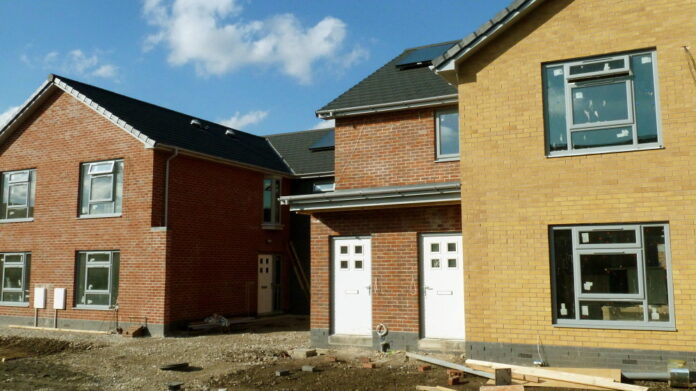 The brick facade of semi-detached new houses