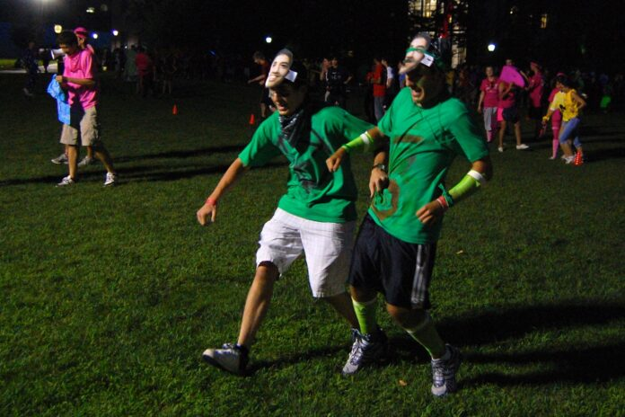 three legged race contestants lurch to the finish line