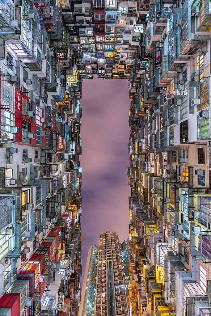 view up from street in Hong Kong, with tall builidngs on all sides