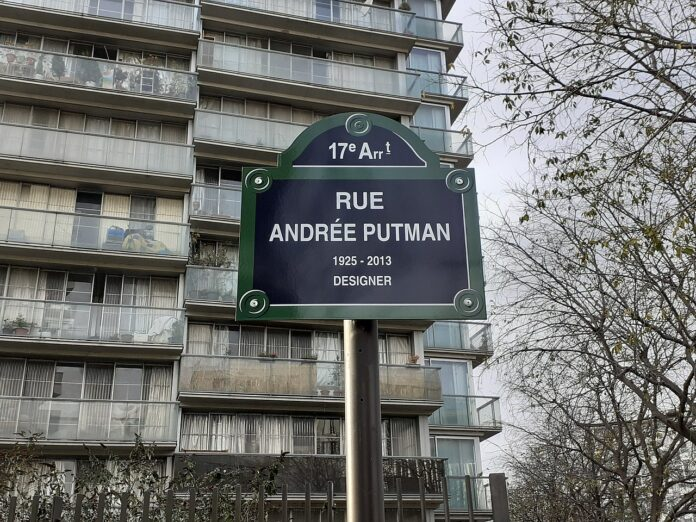 refurbished apartment building with street sign reading Rue Andrée Putman