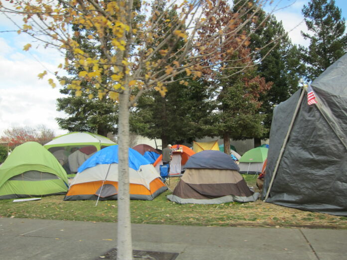 A tent city with many different coloured tents crowded close together
