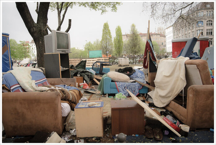 the entire contents of an apartment spread futon a street