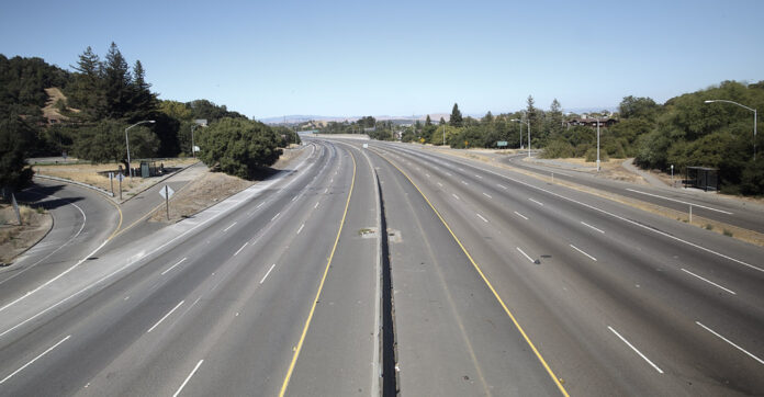 A massive, empty superhighway curves off into the distance