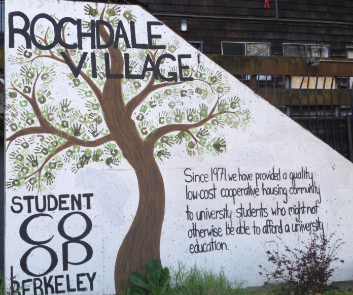 A sign extolls the affordability of student coop housing