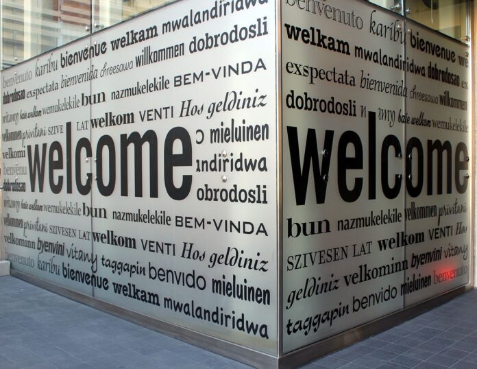 sign with the word welcome in multiple languages